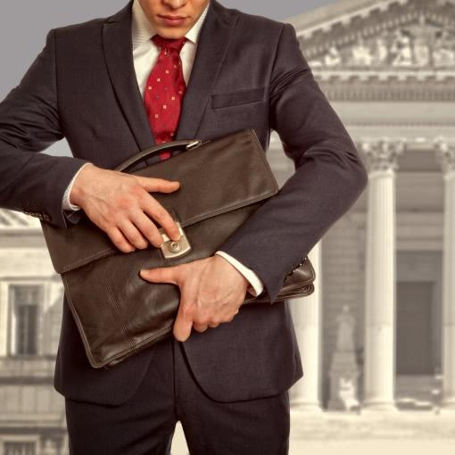 Family lawyer with a briefcase against courthouse